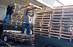 Workers stack pallet after pallet at the Florida Avenue Market in Washington, D.C.