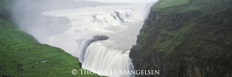 Water cascades over Gullfoss or Golden Falls on the Hvita River in Southwest Iceland.