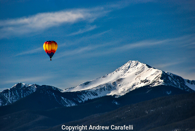 A hot air balloon silently glides past Byer's Peak near Winter Park, Colorado.