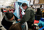Images from the 16th annual Holiday With a Hero shopping day, in Carson City, Nev., on Wednesday, Dec. 18, 2019. The event pairs law enforcement, fire, military and medical officials with homeless children from the Carson City School District McKinney-Vento program for a $100 shopping spree at Walmart.<br /> Photo by Cathleen Allison