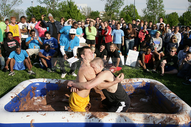 Brian Wagers, left, and Mark Davis, right, wrestle in the pudding wrestling tournament during the 17th annual PiAthon Thursday, April 5, 2012 at Good Barn field in Lexington, Ky. Photo by Brandon Goodwin | Staff