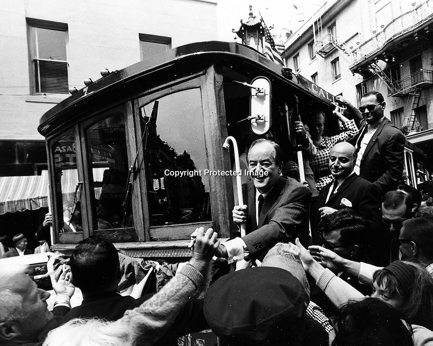 Hubert Humphrey on cable car in San Francisco. (1968 photo by Ron Riesterer