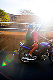 MAURITIUS, a young couple drives on their motorcycle in Port Louis