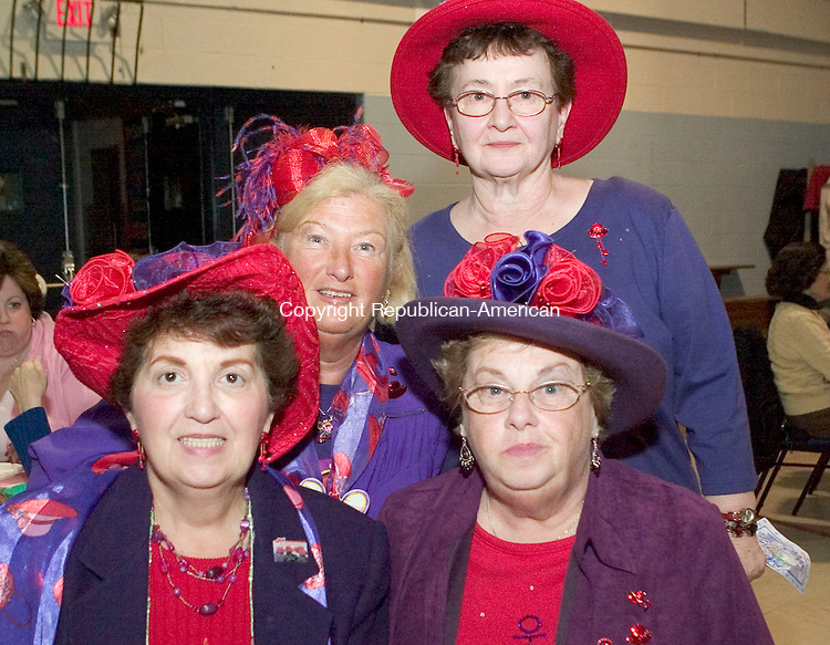 WATERBURY, CT- 02 MAY 2008- 050208JT12-<br /> From left, Red Hat Society members Mary Marchand and Marge Angelicola at top, and Marlene Piersall with Dorthy Caggiano, bottom, of the &quot;Red Hot Honeys&quot; chapter of Waterbury during Saints Peter and Paul Development Committee's Ladie's Night Out at the school in Waterbury on Friday, May 2.<br /> Josalee Thrift / Republican-American