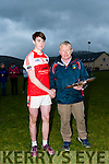 West Kerry GAA chairman Muiris Ó Fiannachta presenting the shield to Daingean Uí Chúis captain Ruairí de Brún after his team defeated An Ghaeltacht during the West Kerry Minors Final at Gallarus GAA Grounds on Sunday afternoon.