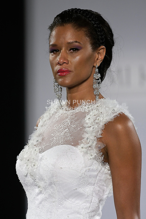 """Model walks runway in a Nairobi wedding dress from the Yumi Katsura Fall 2013 """"Painting The World With Beauty"""" bridal collection, during The Couture Show New York Bridal Fashion Week, October 14, 2012."""