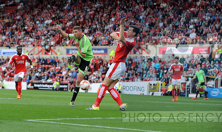 Chris Basham of Sheffield United is challenged by Jordan Williams of Swindon Town<br /> - English League One - Swindon Town vs Sheffield Utd - County Ground Stadium - Swindon - England - 29th August 2015 <br /> --------------------