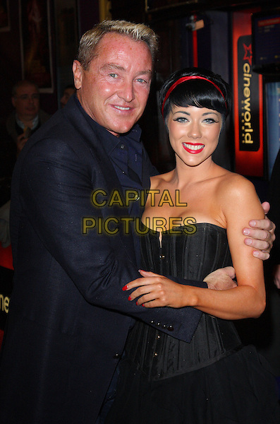 MICHAEL FLATLEY & CIARA SEXTON.UK Premiere of 'Lord of the Dance 3D' at the Cineworld, Haymarket, London, England..March 10th 2011.half length hands strapless corset hairband red cleavage smiling jacket shirt black.CAP/ROS.©Steve Ross/Capital Pictures