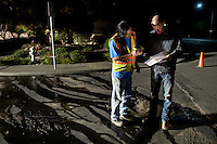 City of Napa Water Supervisor Terry Fong, left, and Dan McLean of Atlas Peak Construction make a plan of action to repair an underground water main which burst after a 6.1 magnitude earthquake hit the San Francisco Bay Area at 3:20 am, in Napa, California, USA, 24 August 2014. More than 70 people were sent to hospital with injuries and power outages darkened multiple cities in northern California after a 6.1-magnitude earthquake struck early on 24 August. The United States Geological Survey (USGS) said the earthquake struck at 3:20 am (1020 GMT) at a depth of 10.8 kilometres. It was located nine kilometres south-west of the Napa wine region, and 81 kilometres north of San Francisco.