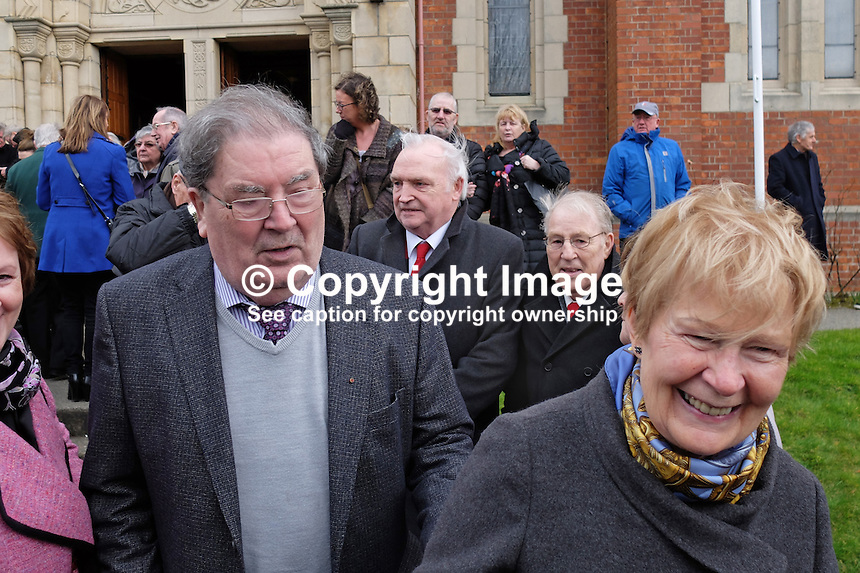 John Hume, retired politician, former leader of the SDLP, former deputy first minister in the N Ireland Assembly, with his wife, Patricia Hume, leaving Pennyburn Chapel, after attending the funeral mass of retired local press photographer, Larry Doherty, 6th March 2015. 201503060492<br />