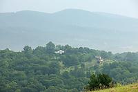 Cyclists ride down the Monticello trail to Mount Alto to view Monticello June 18, 2009 in Charlottesville, Va.