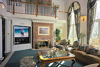 Remote Control Great Room With High Ceiling And Stony Fireplace