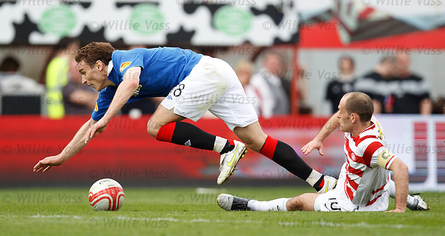 Alex Neil takes out Nikica Jelavic on the edge of the box for a free kick which the Croatian hitman puts into the net