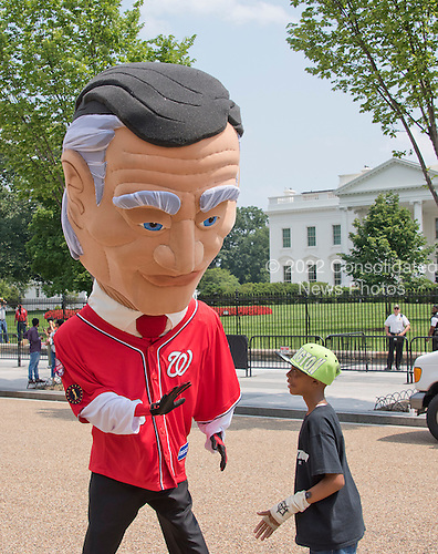 &quot;Calvin Coolidge&quot; the newest of the Washington Nationals' &quot;Racing Presidents,&quot; greets an unidentified fan as he appears on Pennsylvania Avenue in front of the White House in Washington, D.C. on Wednesday, July 1, 2015.  <br /> Credit: Ron Sachs / Pool via CNP