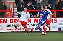 David Mooney of Leyton Orient shoots past Michael Bostwick of Stevenage .- Stevenage v Leyton Orient - npower League 1 - Lamex Stadium, Stevenage - 2nd January 2012  .© Kevin Coleman 2012