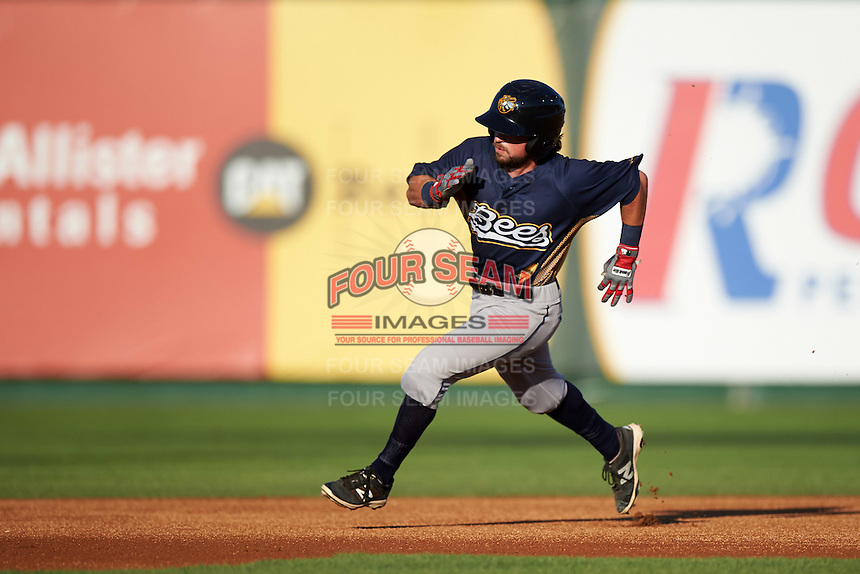 Burlington Bees left fielder Troy Montgomery (4) running the bases during a game against the South Bend Cubs on July 22, 2016 at Four Winds Field in South Bend, Indiana.  South Bend defeated Burlington 4-3.  (Mike Janes/Four Seam Images)