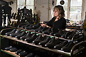 01/05/16<br /> <br /> Helen Lewis inspects a cycling shoe.<br /> <br /> Fuelled by a growing trend for vintage cycling, England's last remaining heavy duty boot-maker, tucked away in the heart of the Derbyshire Peak District, is pedalling a new style of footwear.<br /> <br /> Full story here: http://www.fstoppress.com/articles/vintage-cycle-shoes/<br /> <br />  .For hipster retro-cycling enthusiasts after the authentic vintage look, it's the only English manufacturer of leather shoes designed to work with old-fashioned bike pedal clips.<br /> <br /> For well over a century the family-run firm William Lennon and Co has been hand-making safety boots for the surrounding quarry and lead mining industries.<br /> <br /> And now it is applying the same high level of traditional skill and quality to old-style cycle shoes.<br /> <br /> Located in the small village of Stoney Middleton, the company produces more than 500 pairs of work boots a week and started to make the toe-clip cycle shoes around seven years ago, when the only other manufacturer in Leeds shut down.<br /> <br /> <br /> All Rights Reserved: F Stop Press Ltd. +44(0)1335 418365   www.fstoppress.com.