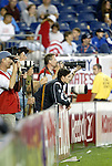04 September 2004: Revs defender Jay Heaps (leaning on signboard) watches second half action while taking a break from warming up. The San Jose Earthquakes defeated the New England Revolution 1-0 at Gillette Stadium in Foxboro, MA during a regular season Major League Soccer game..