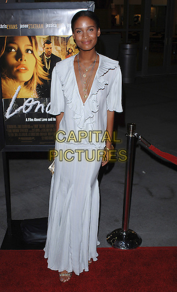 "JOY BRYANT.At the premiere of the film ""London"".Held at the Arclight Cinema, Hollywood, CA, USA,.6th February 2006..full length white dress plunging neckline low cut ruffles long skirt top .Ref: MOO.www.capitalpictures.com.sales@capitalpictures.com.©Capital Pictures."