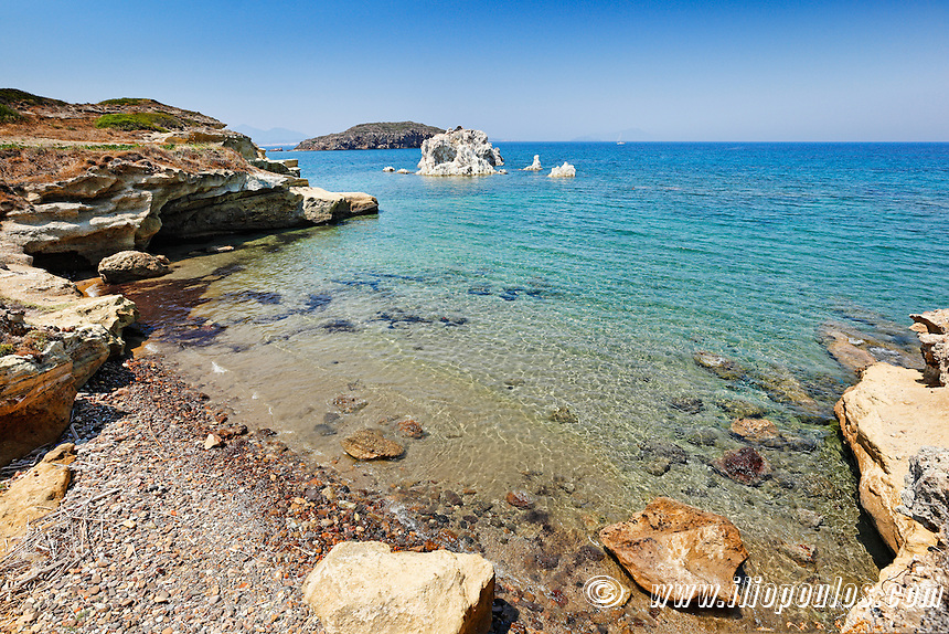 A small beach and white rock formations near Mavrospilia in Kimolos, Greece