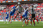 Carl Magnay of Grimsby Town heads clear under pressure from Tom Parkes of Bristol Rovers (left) during the 2015 Vanarama Conference Promotion Final match between Grimsby Town and Bristol Rovers at Wembley Stadium, London<br /> Picture by David Horn/eXtreme aperture photography +44 7545 970036<br /> 17/05/2015