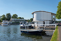 """Henley on Thames, United Kingdom, 29th June 2018, Friday, """"Henley Royal Regatta"""", Qualifying races, [Time Trails] Official, Regatta, Launches, moored by the """"Floating Grandstand"""" with the Phyllis Court Club, Glazed Stand in the Background, Henley Reach, River Thames, Thames Valley, England, © Peter SPURRIER, 29/06/2018"""