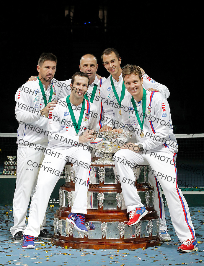 BELGRADE, SERBIA - NOVEMBER 17: L-R Tomas Berdych Radek Stepanek team captain Vladimir Safarik Lukas Rosol and Jan Hayek of Czech Republic hold the winners trophy aloft after a 3-2 victory against Serbia  during the day three of the Davis Cup World Group Final between Serbia and Czech Republic at Kombank Arena on November 17, 2013 in Belgrade, Serbia. (Photo by Srdjan Stevanovic)