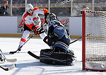 OMAHA, NE - FEBRUARY 9:  Robbie Baillargeon #18 from the Omaha Lancers puts a shot on goal against Michael Bitzer #33 from the Lincoln Stars in the first period at the Battle on Ice Saturday at TD Ameritrade in Omaha, NE. (Photo by Dave Eggen/Inertia)