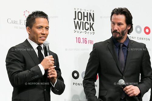 (L to R) Japanese Judo Gold Medalist Tadahiro Nomura and Canadian actor Keanu Reeves speak during the Japanese premiere for the film John Wick on September 30, 2015, Tokyo, Japan. The movie will be released in Japanese theatres on October 16. (Photo by Rodrigo Reyes Marin/AFLO)