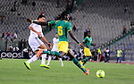 Egyptian players compete against with Senegal s players during their qualifying match of 2015 Africa Cup of Nations in Cairo, Egypt, on Nov. 15, 2014. Senegal won the match by 1-0. Photo by Amr Sayed