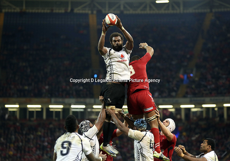 Pictured: Tevita Kavubati of Fiji catches the ball from a line out. Saturday 15 November 2014<br /> Re: Dove Men Series rugby, Wales v Fiji at the Millennium Stadium, Cardiff, south Wales, UK.