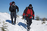 Appalachian Trail - Hikers make their way along the Franconia Ridge Trail during the winter months. Located in the White Mountains, New Hampshire USA.
