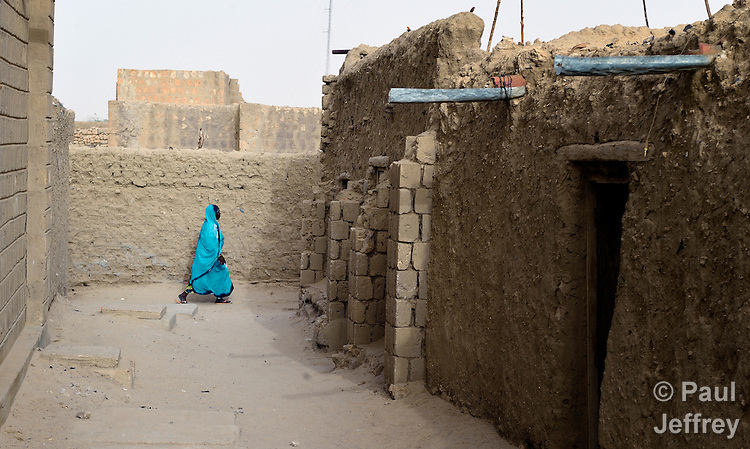 A woman walks along a street in Timbuktu, the northern Mali city that was seized by Islamist fighters in 2012 and then liberated by French and Malian soldiers in early 2013. During jihadist rule, women and girls were not permitted in public unless they were completely covered.
