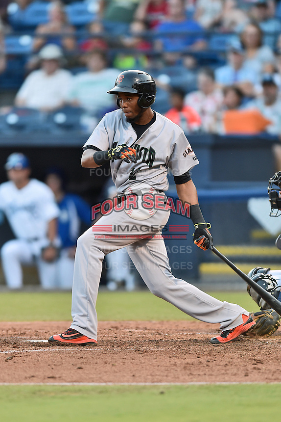 Augusta GreenJackets first baseman Junior Arias (12) swings at a pitch during a game against the Asheville Tourists at McCormick Field on August 5, 2016 in Asheville, North Carolina. The Tourists defeated the GreenJackets 7-6. (Tony Farlow/Four Seam Images)