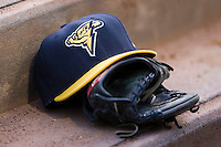 A Trenton Thunder cap rests on top of a glove on the steps of the visitors dugout at Dodd Stadium in Norwich, CT, Tuesday, June 3, 2008.