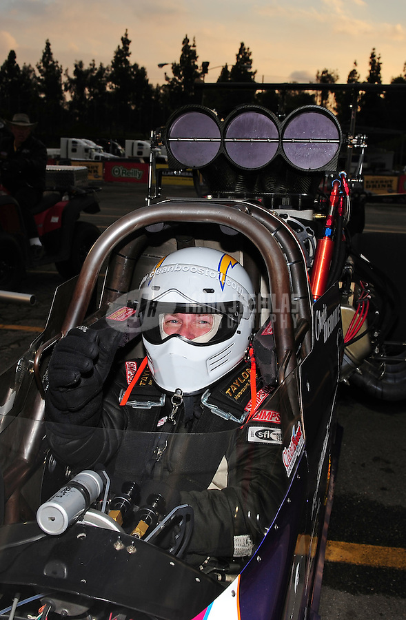 Feb. 12, 2012; Pomona, CA, USA; NHRA top alcohol dragster driver Chris Demke after winning the Winternationals at Auto Club Raceway at Pomona. Mandatory Credit: Mark J. Rebilas-