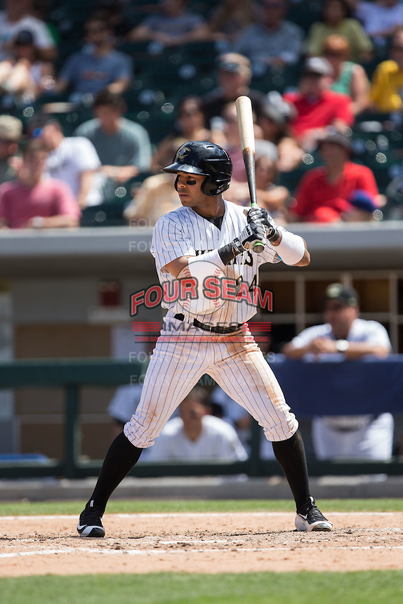 Leury Garcia (24) of the Charlotte Knights at bat against the Indianapolis Indians at BB&T BallPark on June 19, 2016 in Charlotte, North Carolina.  The Indians defeated the Knights 6-3.  (Brian Westerholt/Four Seam Images)