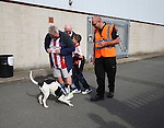Fans are searched by a detection dog during the English League One match at Glanford Park Stadium, Scunthorpe. Picture date: September 24th, 2016. Pic Simon Bellis/Sportimage