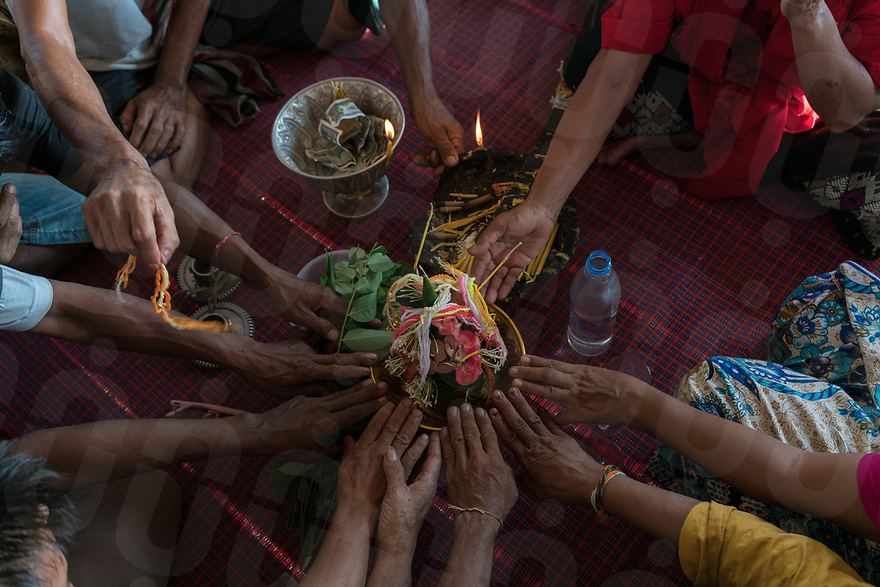 May 1st, 2017 - Nakasang (Laos). The ceremony ends with a traditional sou khuan ceremony where symbolic threads are tied around the wrists of participants. © Thomas Cristofoletti / Ruom