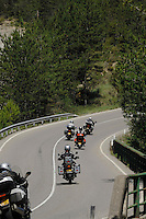 Motorbikes on curving road. Aragon, Spain.