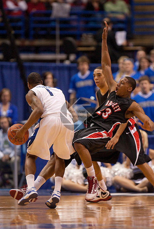 March 5,  2010             Bradley guard Chris Roberts (23) falls backwards after Creighton forward Justin Carter (1) ran into him while driving towards the basket.   Creighton University played Bradley University in Game 4 of the Missouri Valley Conference Tournament at the Scottrade Center in downtown St. Louis, MIssouri on Friday March 5, 2010.  Bradley won, 81-62, and advances.