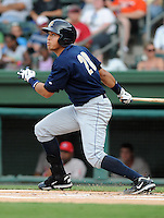 Outfielder Ramon Flores (20) of the Charleston RiverDogs, Class A affiliate of the New York Yankees, in a game against the Greenville Drive on July 31, 2011, at Fluor Field at the West End in Greenville, South Carolina. (Tom Priddy/Four Seam Images)