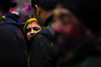 A woman try to see the stage while she attends the Holi Hai festival organized by Indian community in New York City March 31, 2013. Photo by Eduardo Munoz Alvarez / VIEWpress.