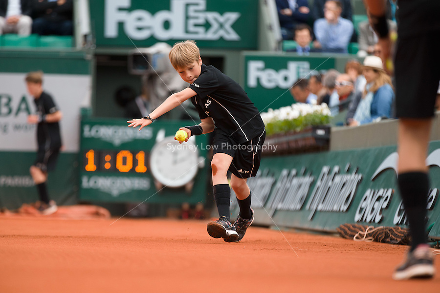 May 26, 2015: A ball kid in action during the 1st round match between David Ferrer (ESP) and Lukas Lacko (SVK) on day three of the 2015 French Open tennis tournament at Roland Garros in Paris, France. Sydney Low/AsteriskImages