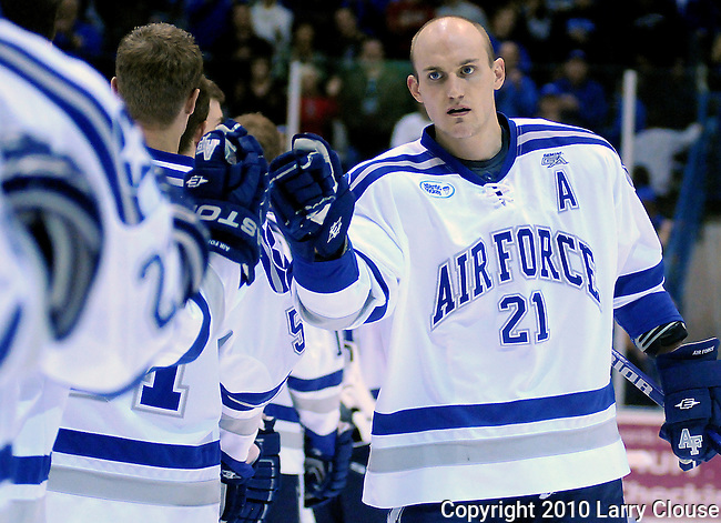 February 6, 2010:   Air Force center, Jacques Lamoureux (21), is introduced prior to a heated match-up between #2 Denver University and Air Force at Cadet Ice Arena, U.S. Air Force Academy, Colorado Springs, Colorado.  #2 Denver defeats Air Force 2-1 in OT.