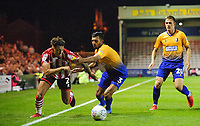 Lincoln City's Kellan Gordon vies for possession with Mansfield Town's Malvind Benning<br /> <br /> Photographer Chris Vaughan/CameraSport<br /> <br /> The EFL Checkatrade Trophy Group H - Lincoln City v Mansfield Town - Tuesday September 4th 2018 - Sincil Bank - Lincoln<br />  <br /> World Copyright © 2018 CameraSport. All rights reserved. 43 Linden Ave. Countesthorpe. Leicester. England. LE8 5PG - Tel: +44 (0) 116 277 4147 - admin@camerasport.com - www.camerasport.com