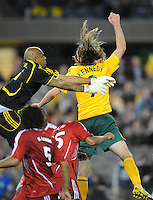 MELBOURNE, AUSTRALIA - OCTOBER 14: Joshua Kennedy from Australia jumps for the ball in a AFC Asian Cup 2011 match between Australia and Oman at Etihad Stadium on October 14, 2009 in Melbourne, Australia. Photo Sydney Low www.syd-low.com