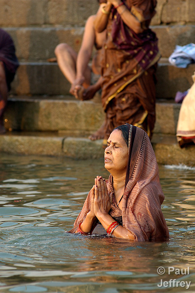 Indians worship in the Ganges River at Varanasi, a sacred site for Hindus.