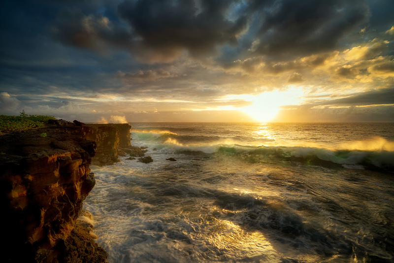 Sunrise and waves atKalilo Point. The Island of Hawaii. The Big island