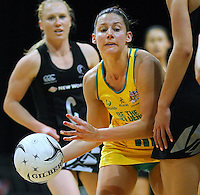 Australia's Madison Browne attempts to pass the ball pass the New Zealand defense in the New World Quad series netball match, Claudelands Arena, Hamilton, New Zealand, Thursday, November 01, 2012. Credit:NINZ / Dianne Manson.
